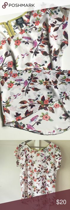 """White Floral Blouse Sheer, lightweight blouse - floral/bird pattern on white. Short sleeves. Round neck. Loose fit. Back zip with lime green detail - about 7"""" long. Blouse is approx 25"""" long in front and 29"""" long in back. About 20"""" from underarm to underarm. 100% Polyester. Worn a couple times - in great condition. Bobeau Tops Blouses"""