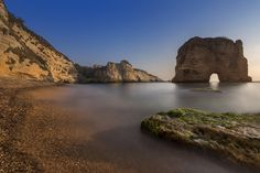 The beautiful cliffs of Raouche during the golden hour. In Lebanon we calle it Raouche sounds like Rawshe which comes from Le Rocher (the rock) after the French named it that way.