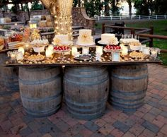This wine barrel table will wow guests! Wine and cheese with a rustic slant - casual and chic.