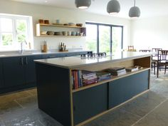 bespoke kitchen island with oak cabinet and sliding doors