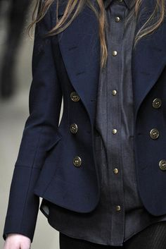 Gorgeous tone on tone dark blues with brushed gold. The classic navy blazer strikes again.