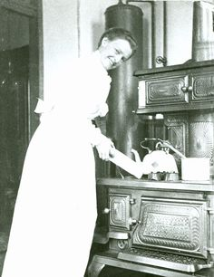 """Really great article on early 20th century kitchens.   A rare kitchen photograph from Victoria, B.C. c1900, showing the lady of the house at her """"NEW HOUSEHOLD"""" range. A hot water tank is behind, connected to the stove to provide hot water for washing and bathing."""