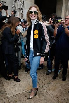 100 best dressed of 2014 - street style, Natalia Vodianova in a chic varsity jacket, white turtleneck + denim skinny jeans and metallic heels