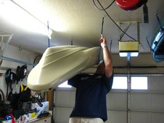 Kayak Rack Kayak Garage Storage How-To Kayak Storage Rack, Kayak Rack, Garage Storage, Storage Organization, Garage Tools, Kayak Fishing, Outdoor Storage, Storage Solutions, Fishing