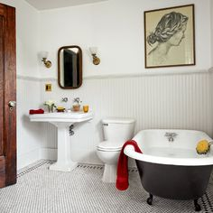 A classic hex-tile floor sets the stage for a period claw-foot tub and pedestal sink. | Photo: Nathan Kirkman | thisoldhouse.com