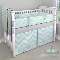 Gender Neutral Baby Bedding in Solid Silver Gray, Mint Zippy Chevron, Mint Quatrefoil. Created using the Nursery Designer® by Carousel Designs where you mix and match from hundreds of fabrics to create your own unique baby bedding.