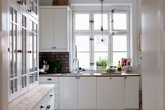 white bead board cupboards yes! different windows and I'm not totally into the brick but I like the recessed range top