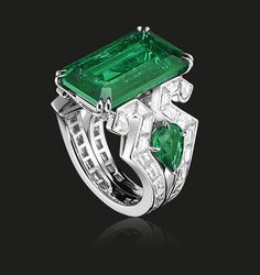 Emerald Art Deco Ring | This stunning Columbian emerald is set in a white gold Art Deco style ring, shouldered by baguette diamonds and two pear shaped emeralds. A magnificent example of the House of Tabbah's craftsmanship and stones expertise.   Rectangular shaped emerald 10.70 cts  #houseoftabbah #tabbah