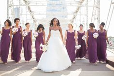 LOVE these plum dresses for a fall wedding! Photo on the pedestrian bridge, Nashville TN. Plum dresses by Bill Levkoff, bride's dress by #Watters #WTOO. #BillLevkoff From Meya and Justin's luxury wedding at Scarritt Bennett and Hilton Hotel Nashville TN. Photographer: Krista Lee, Krista Lee Photography Planner: Angela Proffitt, Luxury and celebrity wedding planner. #kristaleeweddings #bridesmaids #plumwedding #plumdress #plum #wedding #nashvillewedding #pedestrianbridge