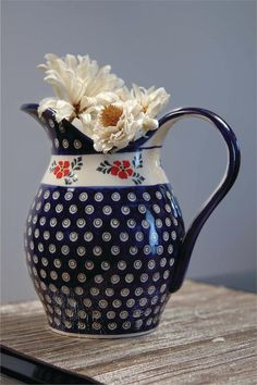 Enamored with the idea of using a polish pottery pitcher as the vase for a floral arrangement...