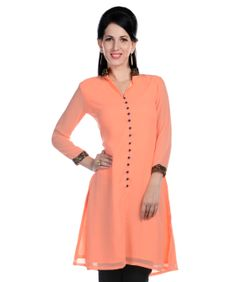 A traditional powerhouse that packs a punch, sounds like our edit of casual summer kurtis. These ethnic numbers go well with leggings or denims. From bright summer hues to ice-cream colors, these kurtis spell elegance and accentuate your curvaceous figure. So, come take a look at our rich designs and prints and take your pick. We guarantee you'll still be turning heads in this Indian attire.BRAND: Drapes & SilhouettesCATEGORY: KurtaCOLOUR: PeachMATERIAL: Georgette
