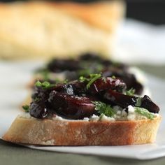 wine and balsamic vinegar roasted mushrooms on top of goat cheese and crostini = YUM.