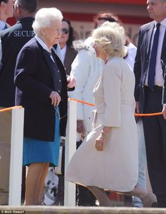 Camilla, Duchess of Cornwall, curtsies as she greets the Queen at the Royal Windsor Horse Show on 13 May 2015.