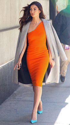 2d0c880556f Lily Aldridge in a one-shoulder orange Victoria Beckham dress