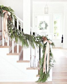 We think a lush cedar garland draped along a banister is always stunning, but we were floored when we saw this layered, personalized greenery display on Monika Hibbs's feed.