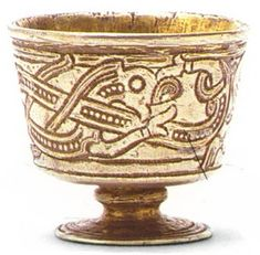 Vikings:  Intertwining Dragon embellished on silver #Viking cup,  9th century CE. Jelling, Denmark.