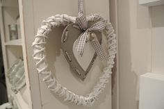 White Wicker Heart Hanging - Divine Shabby Chic Hanging heart with natural heart inner   Gingham ribbon detail and silver ornate carved hearts added to bow  Measuring 20cm   Wonderful addition to the home  Ideal for weddings or just a simple gift for a loved one      Was £5.50 Now £4.13