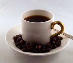 Espresso is a strong, somewhat bitter version of brewed coffee made from dark-roasted coffee beans.