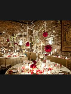 quite like the tree its hanging from, look nice with fairy lights or the candles that are battery powered in small little jars. and maybe not the red flowers so other matching colour would look lovely