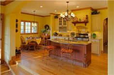Open Traditional Kitchen by Amy  Conner-Murphy