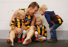 Sam Mitchell of the Hawks celebrates win with his twin daughters Emmerson Mitchell and Scarlett Mitchell and son Smith Mitchell (R) during the round nine AFL match between the Hawthorn Hawks and the Gold Coast Suns at Melbourne Cricket Ground on May 26, 2013 in Melbourne, Australia. (May 25, 2013 - Source: Michael Dodge/Getty Images AsiaPac)