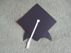 """Graduation Cap made w/ Creative Memories Shape Maker System using 2"""" Square & 2"""" Circle Cartridges + the smallest circle on the Double Circle Punch to take """"bites"""" out of 2"""" circle cut in 1/2.  Freehand cut tassle!:)  Contact me or visit my website for these products & more:  http://www.mycmsite.com/candicesmall  or my Facebook Business Page:  Candice's Scrapbooking Michigan"""
