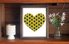 This colorful University of Michigan Wolverines Heart print is an original pattern, designed with the University of Michigan Wolverines colors and symbols in mind. This print come in a variety of sizes (please see drop down menu on the right).  This print can come with or without the words, Michigan Wolverines (please see drop down menu on the right).  This unique University of Michigan Wolverines Heart print looks great by itself, or on a gallery wall with other prints. It would be a…