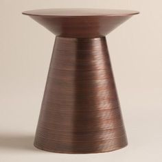 Our sophisticated drum table is handcrafted and hand finished in aged copper by skilled Indian artisans, creating a ring effect. Slightly varying ring sizes are a result of the table's handmade nature, making each a unique work of art.