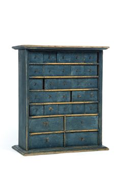 """DIMINUTIVE APOTHECARY CHEST. American, 19th-20th century, chestnut and pine. Twenty-five small drawers over four medium drawers, and blue paint. 25""""h. 22""""w. 10""""d."""
