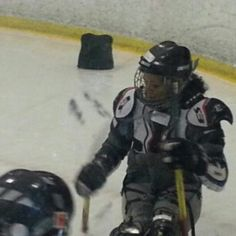 Lisa playing sled hockey.