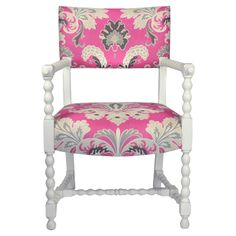 Vintage bobbin chair with a pop of pink.