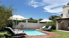 The four-star Spier Hotel is on the famous Spier Wine Estate in Stellenbosch, which is one of the quaint Cape Town Winelands town in South Africa. Rolling hills, beautiful gardens with walkways connect the hotel rooms with the main building. E Farm, Shady Tree, Hotels, The Great Outdoors, Beautiful Gardens, South Africa, Swimming Pools, Child Friendly, Patio