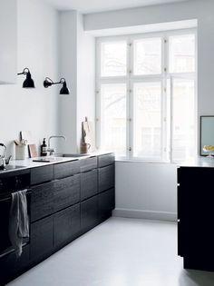 Black cabinets, white walls in kitchen