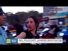 ▶ POLICE BRUTALITY - Philadelphia Cop Sucker Punches Woman In The Face During Parade