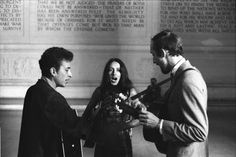 Bob Dylan, Joan Baez and Paul Stookey singing inside the Lincoln Memorial. August 28, 1963.