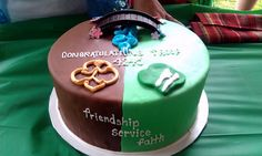 Bridging Ceremony Cake   I may try to make this next year for the Brownies I have who will be bridging to Juniors!