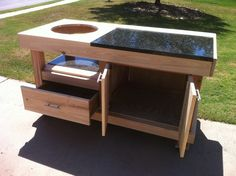 This is a Big Green Egg table that I built for a friend of mine over the weekend. It is designed to hold the medium egg. Large Green Egg, Big Green Egg Table, Green Eggs, Big Green Egg Outdoor Kitchen, Backyard Kitchen, Summer Kitchen, Homemade Router Table, Woodworking In An Apartment, Grill Table