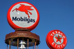 Photograph by Stuart Litoff.  The #tops of #vintage, #rusty #Mobil and #Texaco #gas #pumps.