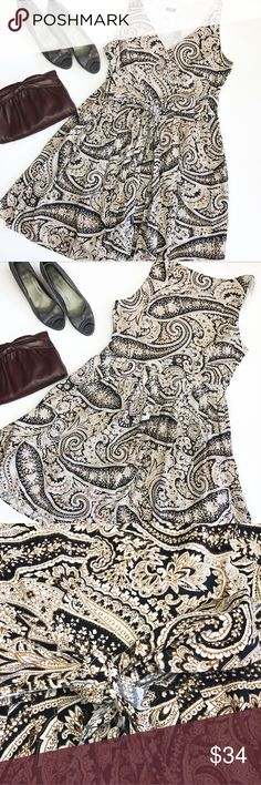 J. Crew navy white gold paisley fit flare dress 12 J. Crew factory gorgeous dress in excellent condition. Fit and flare shape with v neckline. Side zip, but is closed at top of zip. Attached belt to tie into a bow. Lined. 100% cotton. Size 12, may fit smaller - check measurements. Ptp 20, length 37. Shoes and purse also available ask for a tag J. Crew Dresses