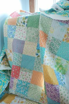 scrap quilt/ straight quilting changing directions each square