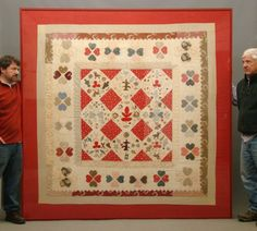 """19th c. folk art pieced quilt made of various solid and printed fabrics of hearts, birds, flowers, clover leaves, animals etc.. Red calico border. Professionally framed. 83"""" Square. Piece was lot 412 in Sotheby's """"Important American"""" sale January 21, 22, 2011 (pg. 236)."""