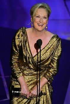 """Meryl Streep accepts the Oscar for best actress in a leading role for """"The Iron Lady"""" at the 2012 Academy Awards."""