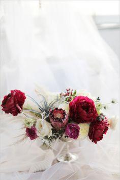 red white and pink centerpiece #weddingreception #weddingflorals #weddingchicks http://www.weddingchicks.com/2014/03/03/silver-wedding-ideas-2/