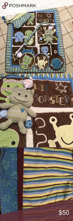 Crib bedding set Adorable monster bedding!  The comforter is reversible with monsters on the front and green and real circles on the back (last pic). The mobile spins and plays music with an adorable matching plush hanging. Also comes with 2 crib sheets, crib skirt, and three decorative plush wall pillows. All comes from pet and smoke free home and is in excellent condition. The sheets show their use a little bit are also in good condition. Retailed for about $225 Cocalo Accessories