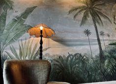 The Esplanade Hotel in St Kilda, Melbourne. #stkilda #espy #visitmelbourne #bottlegreen #greeninterior #distressedmural #relaxeddining #botanicalmural #botanicalinterior #jurassicdecor #indoormural #interiormural #botanicaldecor #riparian #primordialchic #wildinterior #naturalmural #rusticcontemporary #muraldetail #palmtreemural #palms #decorativepalms #decorativeart #spikypalms #greenscenery #desertedbeach #retrochair #velvetchair #vintagelamp #olivepalette #greenpalette #lampstand Botanical Interior, Botanical Decor, Green Scenery, Visit Melbourne, Green Palette, Painted Walls, St Kilda, Rustic Contemporary, Vintage Lamps