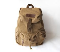 DETAILS:  *Color: Tan *Material: top quality canvas and 100% Genuine Cow Leather  *Hardness: Medium soft  *Padded camera insert can be removable *One zipper pocket inside *One waterproof cover is folded in the zipper pocket at the bottom of the bag *The inner room is big enough to hold iPa...