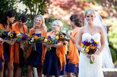 I like the orange shawls for the bridesmaids. I could do that, purple and orange are my colors