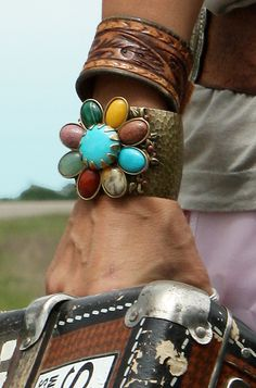 vintage leather western cuff and i like the colors on the flower one. the 'suitcase' looks awesome too! :)