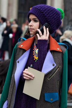 mixed-colour biker jacket + statement necklace and super-cute purple toque with green pom-pom