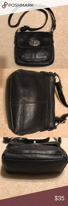 Fossil Small Black Leather Cross-body Bag Excellent preowned condition. Front flap with turn-lock closure. Features one large slip pocket on the front beneath the flap and one zip and two slip pockets inside. Adjustable leather strap. Heavy brushed silver hardware. Top quality construction. Fossil Bags Shoulder Bags